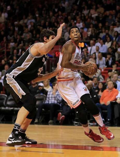 MIAMI, FL - FEBRUARY 09: Hassan Whiteside #21 of the Miami Heat drives on Boban Marjanovic #40 of the San Antonio Spurs during a game  at American Airlines Arena on February 9, 2016 in Miami, Florida. NOTE TO USER: User expressly acknowledges and agrees that, by downloading and/or using this photograph, user is consenting to the terms and conditions of the Getty Images License Agreement. Mandatory copyright notice: Photo: Mike Ehrmann, Getty Images / 2016 Getty Images