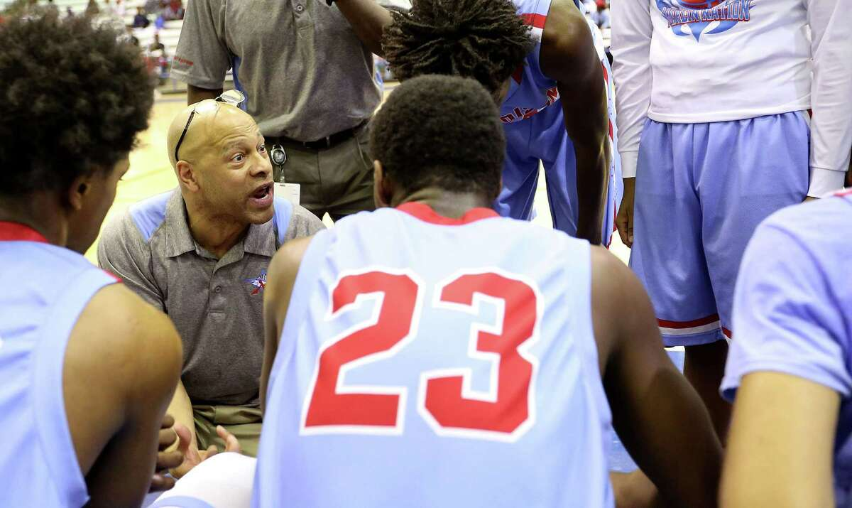 Madison's head coach Craig Mauren talks to his team in the second half of high school basketball action against Yates at Barnett Fieldhouse on Tuesday, Feb. 9, 2016, in Houston. Yates won the game 91-78.