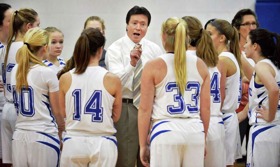 Hoosic Valley coach Larny Chapko, center, with players during Saturday's game against Albany Academy for Girls Feb. 6, 2016 in Schaighticoke, NY.  (John Carl D'Annibale / Times Union) Photo: John Carl D'Annibale / 10035301A