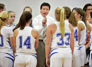 Hoosic Valley coach Larny Chapko, center, with players during Saturday's game against Albany Academy for Girls Feb. 6, 2016 in Schaighticoke, NY.  (John Carl D'Annibale / Times Union)