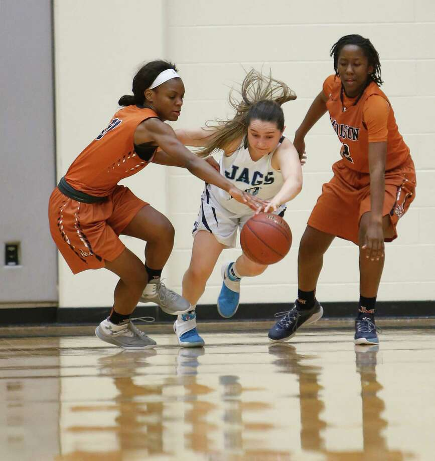 Johnson Tara Molina  steals the ball  between Madison's Denaija Daniels and Anjanna Bardwell.Johnson v Madison for district title in the girls District 26-6A  on Tuesday, February 9 2016 at at Littleton Gym. Photo: Ronald Cortes, Freelance / For Express News