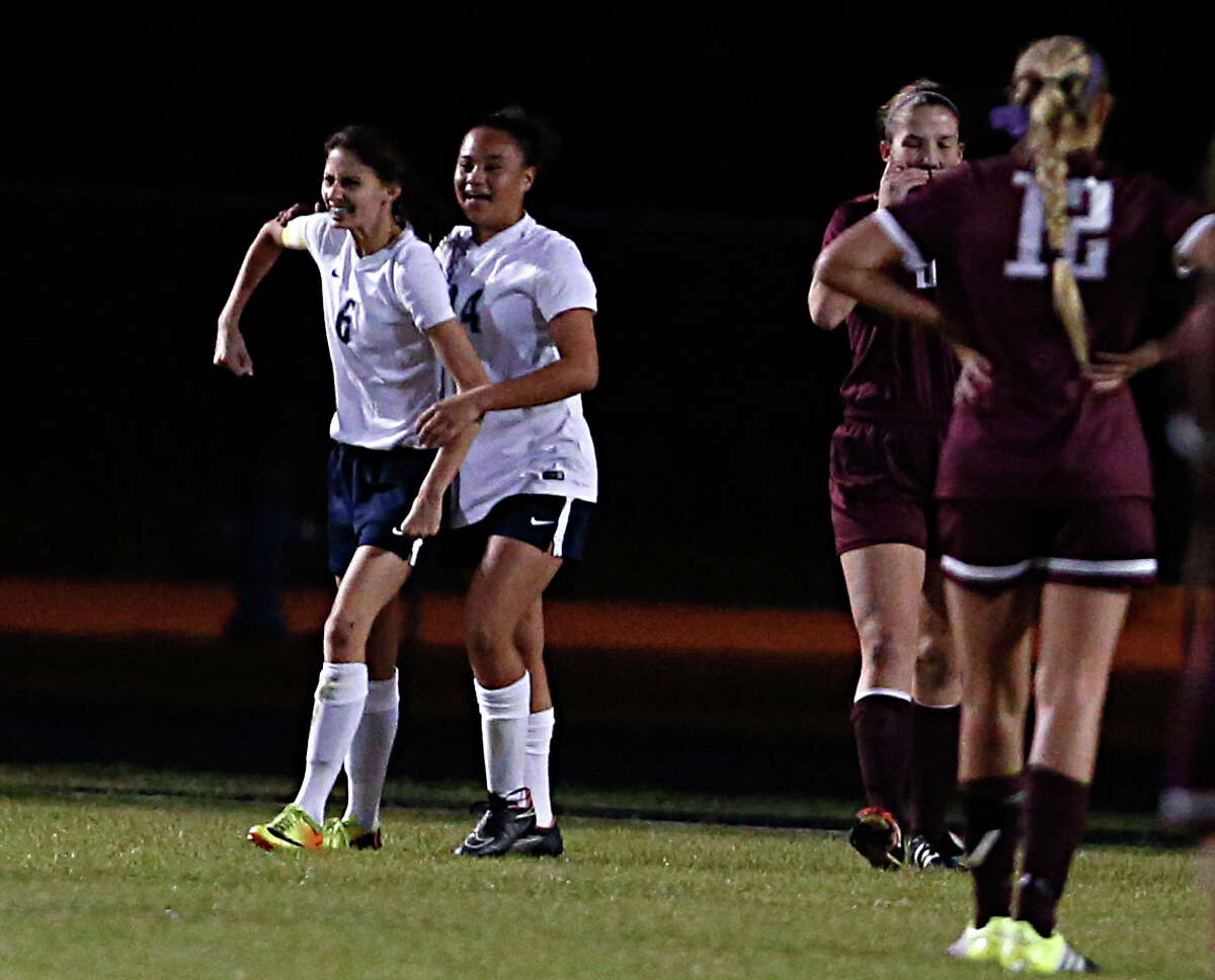 Cy Ranch's Brie Guerrero left, pumps her fist while celebrating after scoring a goal with teammate Alyssa Austin 2nd from left, Cy-Fair's during the first half of girls high school game action at Cypress Ranch High School Tuesday, Feb. 9, 2016, in Houston.