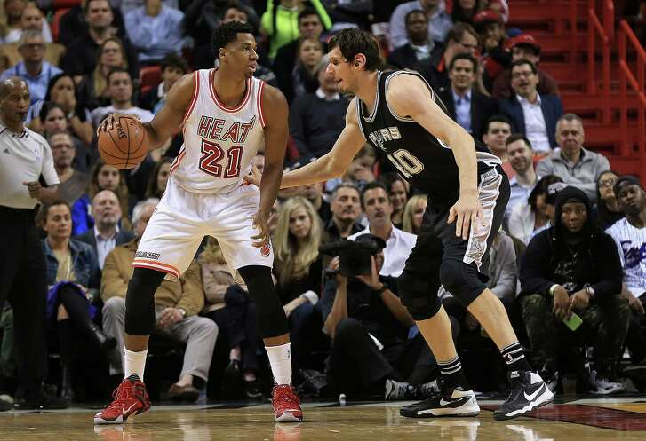 MIAMI, FL - FEBRUARY 09: Hassan Whiteside #21 of the Miami Heat posts up Boban Marjanovic #40 of the San Antonio Spurs during a game  at American Airlines Arena on February 9, 2016 in Miami, Florida. NOTE TO USER: User expressly acknowledges and agrees that, by downloading and/or using this photograph, user is consenting to the terms and conditions of the Getty Images License Agreement. Mandatory copyright notice: