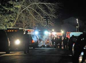 Police and fire personnel work the scene of a fire on Schalren drive on Tuesday Feb. 9, 2016 in Colonie, N.Y.  (Michael P. Farrell/Times Union)