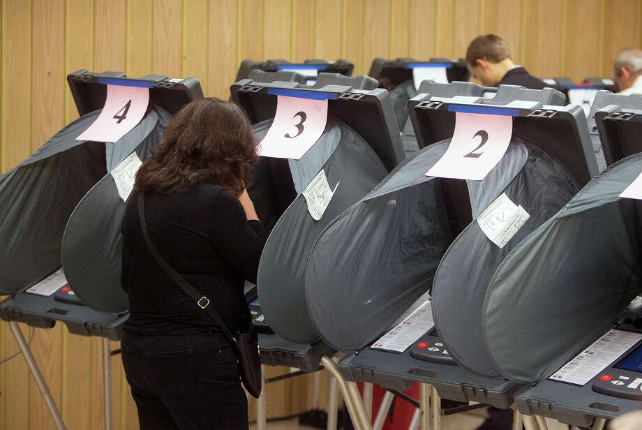 Voters casting ballots. (Cody Duty / Houston Chronicle) Photo: Cody Duty, Staff / Ã  2015 Houston Chronicle