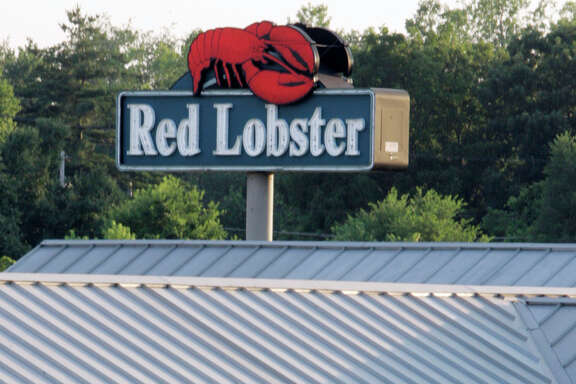 """FILE - In this June 20, 2005, file photo, a Red Lobster restaurant is seen in Fairview Heights, Ill. Red Lobster said in a statement that its sales surged after Beyonce mentioned the chain in a """"Formation"""" lyric. The seafood chain known for its cheddar biscuits says sales surged 33 percent on Sunday, Feb. 7, 2016, from a year earlier. (AP Photo/James A. Finley, File)"""