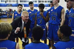Boys basketball: The story behind Tivy coach Brian Young and his ties - Photo