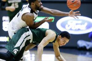 Purdue upsets Spartans in OT - Photo