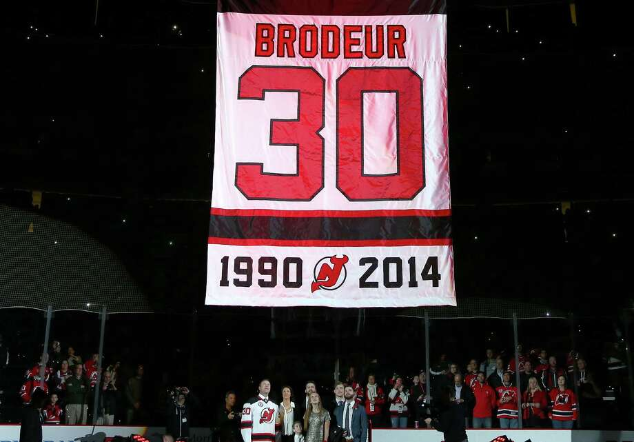 NEWARK, NJ - FEBRUARY 09:  Former New Jersey Devils goaltender Martin Brodeur and his family watch as his banner is lifted during his jersey retirement ceremony before the game between the New Jersey Devils and the Edmonton Oilers on 9, 2016 at Prudential Center in Newark, New Jersey.  (Photo by Elsa/Getty Images) ORG XMIT: 574714613 Photo: Elsa / 2016 Getty Images