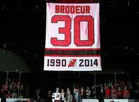 NEWARK, NJ - FEBRUARY 09:  Former New Jersey Devils goaltender Martin Brodeur and his family watch as his banner is lifted during his jersey retirement ceremony before the game between the New Jersey Devils and the Edmonton Oilers on 9, 2016 at Prudential Center in Newark, New Jersey.  (Photo by Elsa/Getty Images) ORG XMIT: 574714613