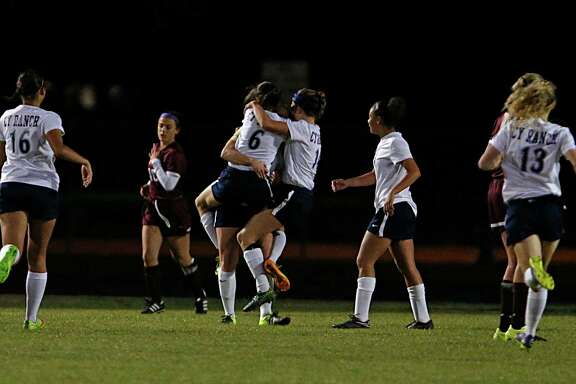 Cy Ranch players pile onto Jessie Gerow after she scored the first goal against Cy-Fair on Tuesday.