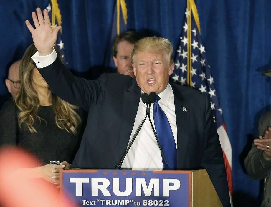 Republican presidential candidate, businessman Donald Trump waves to supporters during a primary night rally, Tuesday, Feb. 9, 2016, in Manchester, N.H.  Photo: David Goldman, Associated Press