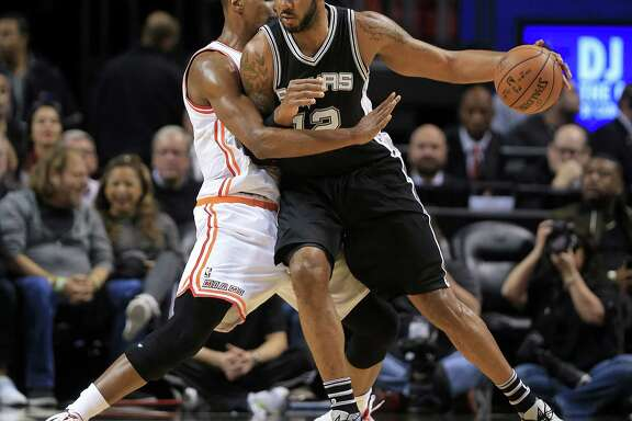 MIAMI, FL - FEBRUARY 09: LaMarcus Aldridge #12 of the San Antonio Spurs posts up Chris Bosh #1 of the Miami Heat during a game  at American Airlines Arena on February 9, 2016 in Miami, Florida. NOTE TO USER: User expressly acknowledges and agrees that, by downloading and/or using this photograph, user is consenting to the terms and conditions of the Getty Images License Agreement. Mandatory copyright notice:  (Photo by Mike Ehrmann/Getty Images)