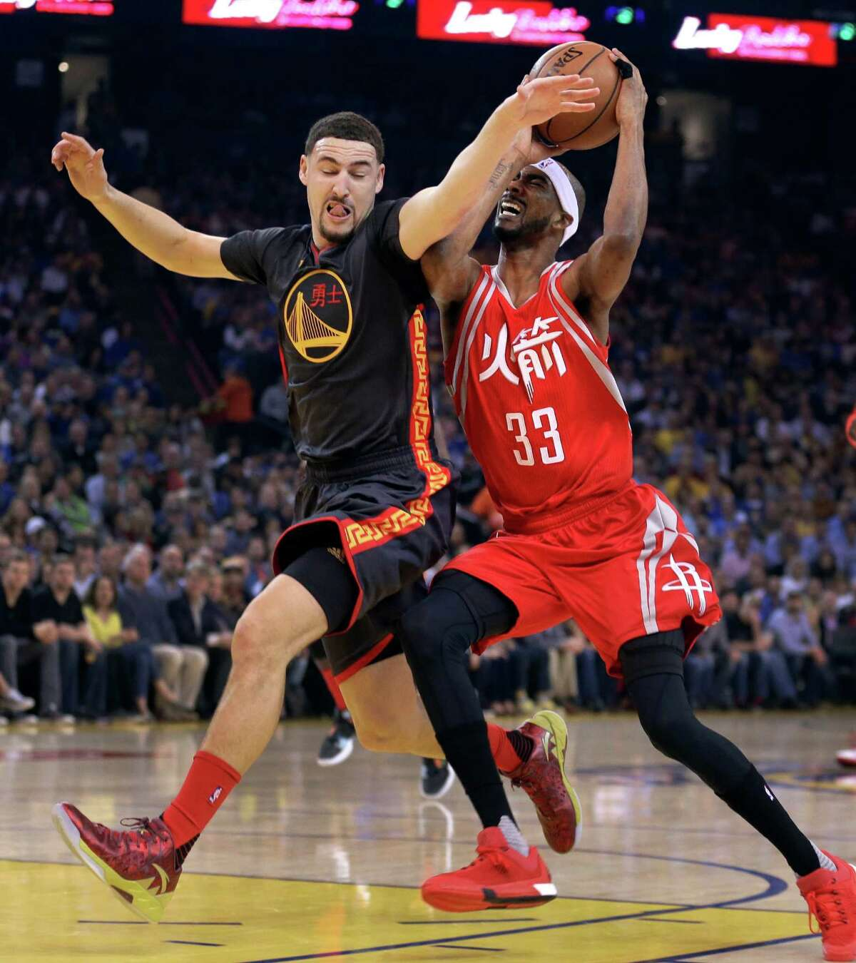 Houston Rockets' Corey Brewer, right, has his shot blocked by Golden State Warriors' Klay Thompson (11) during the first half of an NBA basketball game Tuesday, Feb. 9, 2016, in Oakland, Calif. (AP Photo/Ben Margot)