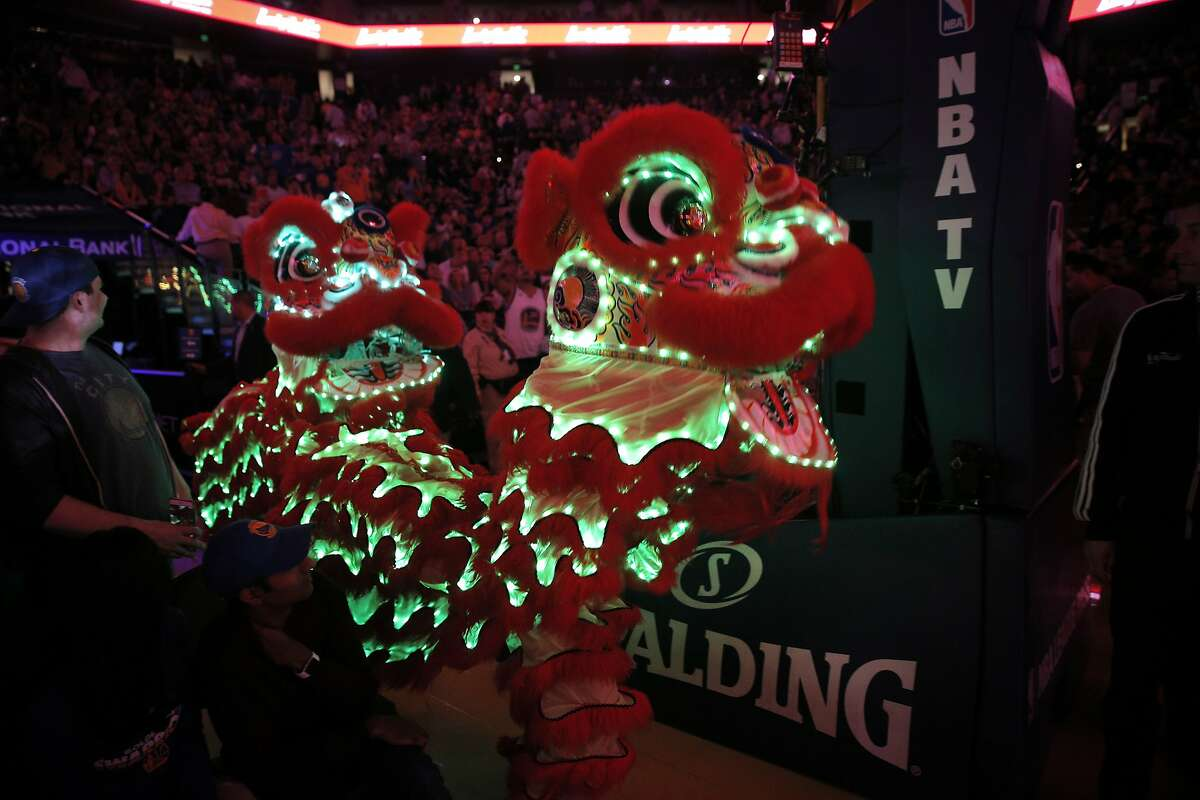 Chinese dragons enter the court during halftime of the game between the Golden State Warriors and the Houston Rockets at Oracle Arena in Oakland, Calif., on Tuesday, February 9, 2016.