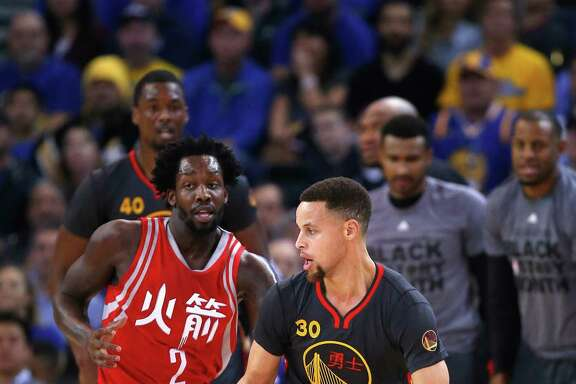 Rockets guard Pat Beverley, left, had the unenviable task Tuesday night of having to chase the Warriors' Steph Curry, who finished with 35 points.
