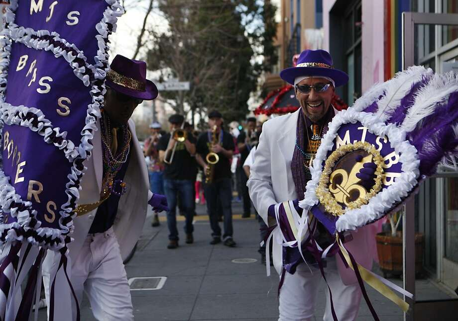 MJ's Brass Boppers lead off the performances during the fifth annual Fat Tuesday parade through the Mission District in San Francisco. Photo: Brittany Murphy, The Chronicle