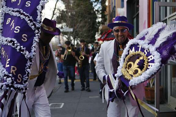MJ's Brass Boppers lead off the performances during the fifth annual Fat Tuesday parade through the Mission district in San Francisco, Calif., on Tuesday Feb. 9, 2016