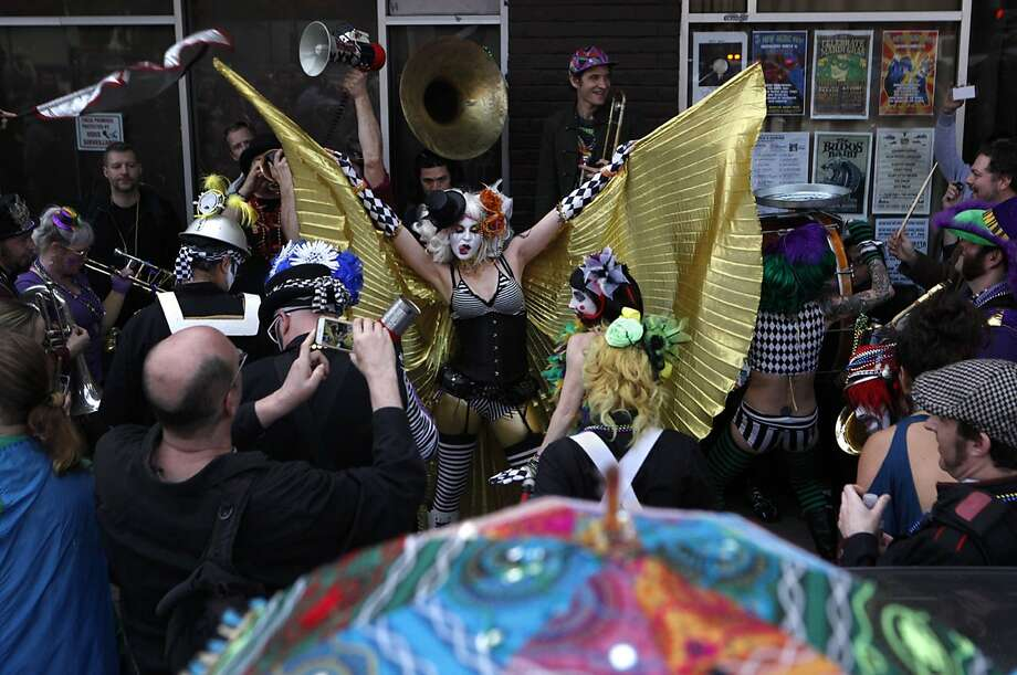 The Mermaid Atlantis (center) performs with the Trash Kan Marchink Band outside of the Brick & Mortar Music Hall after the Mardi Gras parade in San Francisco. Photo: Brittany Murphy, The Chronicle