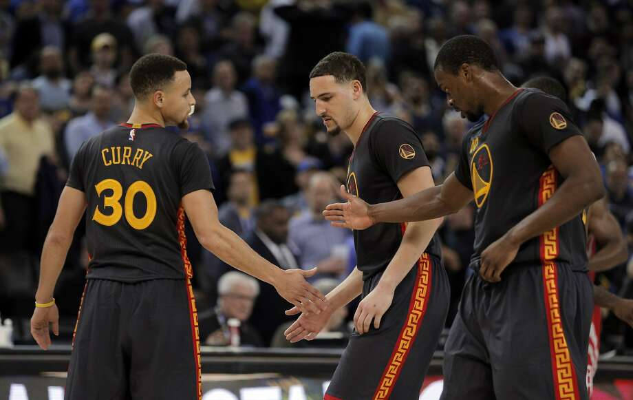Stephen Curry (30) high fives Klay Thompson (11) and Harrison Barnes (40) during the second half of the game between the Golden State Warriors and the Houston Rockets at Oracle Arena in Oakland, Calif., on Tuesday, February 9, 2016.  The Warriors won 123-110. Photo: Carlos Avila Gonzalez, The Chronicle