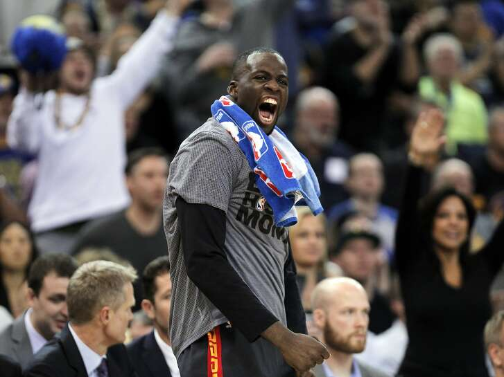 Draymond Green (23) reacts to a blocked shot by Andrew Bogut (12) during the second half of the game between the Golden State Warriors and the Houston Rockets at Oracle Arena in Oakland, Calif., on Tuesday, February 9, 2016.  The Warriors won 123-110.