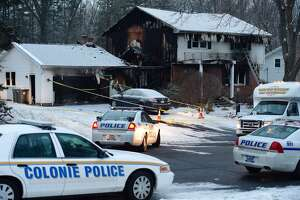 Murder-suicide probed in fire at Colonie officer's home - Photo