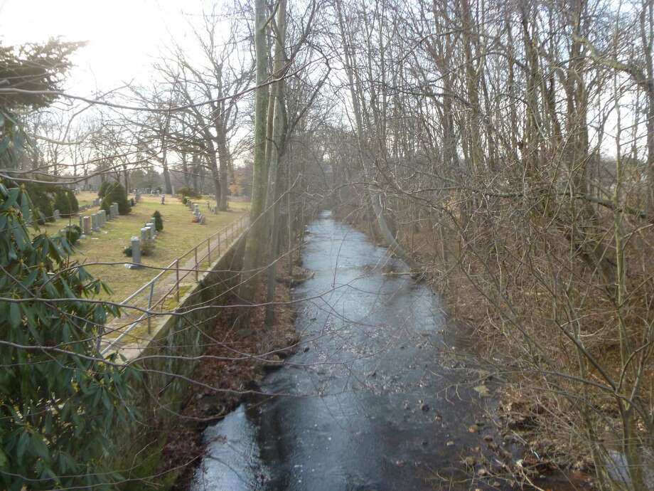 A section of land on Hecker Avenue running along the Stony Brook River the town of Darien is considering buying to preserve as open space. The Board of Selectmen voted Monday to authorize the purchase of the 1.24 acres on Hecker Avenue for a potential wooded shortcut between Town Hall property and the Darien Library and police station. Photo: Martin B. Cassidy / Hearst Connecticut Media / Darien News
