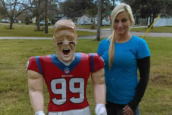 Della Meredith with the five-foot J.J. Watt statue she carved.