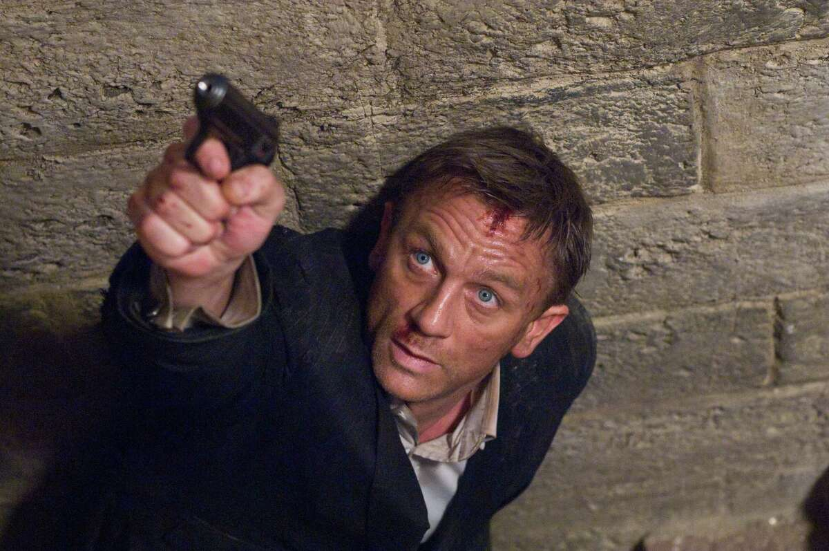 James Bond 007, played by Daniel Craig, is filmed pursuing an MI6 traitor during a shoot at Pinewood Studios. Pinewood is undergoing a strategic review that could result in a sale of the parent company of the studio where