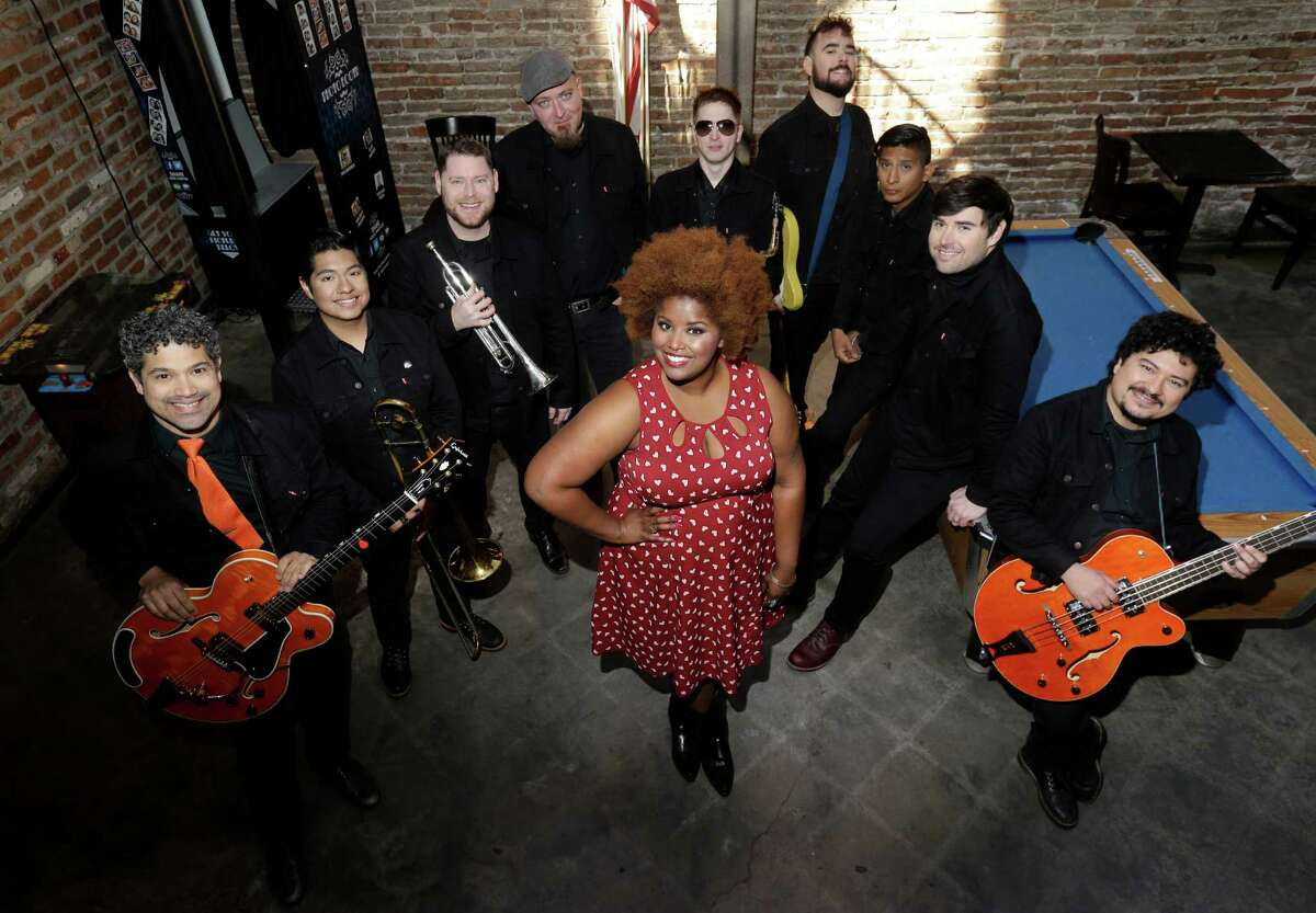 The Suffers with lead singer Kam Franklin, center, pose during a break while filming a new music-based ad for the city, using a remix of their song Really Great Day, shown Saturday, Jan. 23, 2016, in Houston. ( Melissa Phillip / Houston Chronicle )