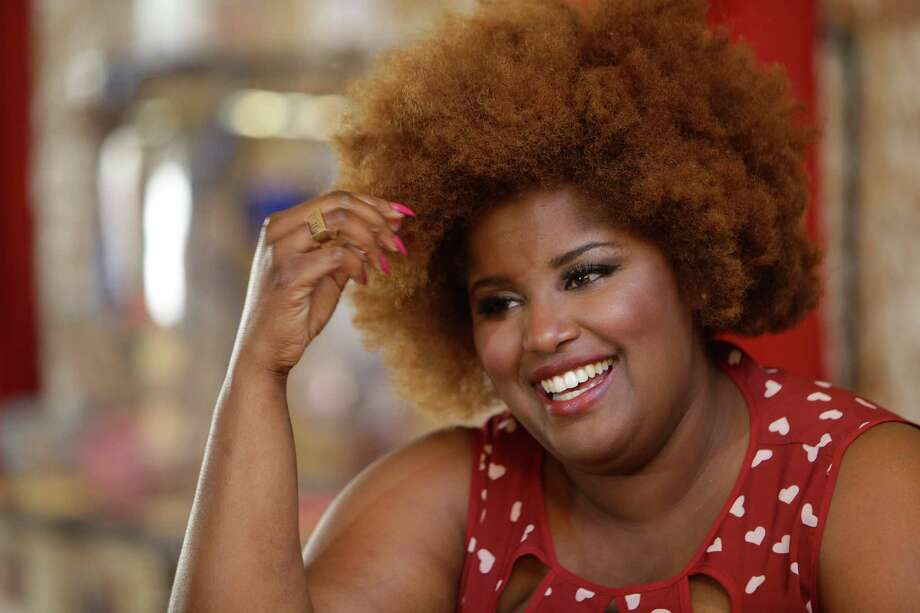 Kam Franklin, lead singer of The Suffers, is slated to sing the National Anthem before Thursday night's Houston Astros game at Minute Maid Park. Photo: Melissa Phillip, Staff / © 2016 Houston Chronicle