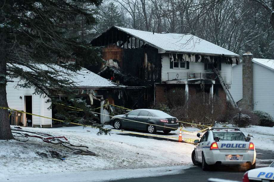 Law enforcement on the local and state level investigate a fatal fire Wednesday morning, Feb. 10, 2016, involving a Colonie Police officer and his family at 35 Schalren Dr. early Tuesday in Colonie, N.Y. (Skip Dickstein/Times Union) Photo: SKIP DICKSTEIN
