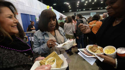 Friends and family enjoy the food and festivities at the Sabine Area Restaurant Association's 33rd annual Taste of the Triangle event Tuesday night at the Beaumont Civic Center. Attendees could sample the spectrum of local cuisine from restaurants throughout the region and get their fill of any last-minute decadence before the Lenten season begins. Photo taken Tuesday, February 9, 2016 Kim Brent/The Enterprise