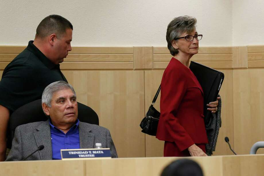 The South San Independent School District board president Connie Prado (center) along with trustees Carlos Longoria (left standing), Trinidad Mata (left) and Stacey Estrada (right) leave for an close executive session during a board meeting on Tuesday, Feb. 9, 2016. Among the topics to discussed was for an informal review regarding the Texas Education Agency Commissioner's intent to appoint a conservator for the school district. Judy Castleberry, former Region 20 executive director, is to assume that role but did not make an appearance at the meeting.  (Kin Man Hui/San Antonio Express-News) Photo: Kin Man Hui, Staff / San Antonio Express-News / ©2016 San Antonio Express-News