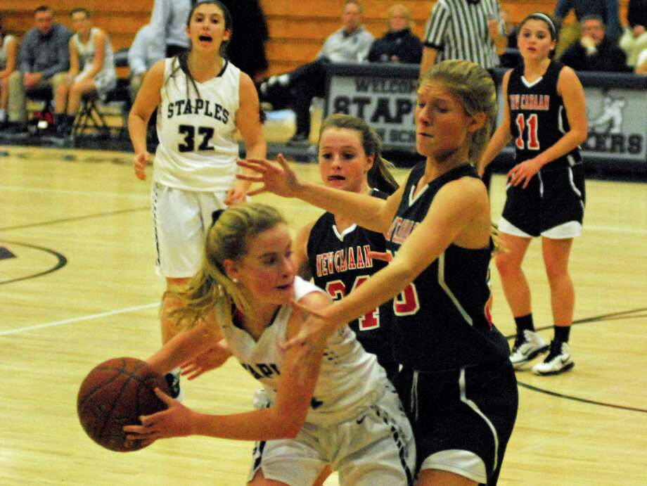 New Canaan's Campbell Armstrong, right, defends Staples' Ellie Fair during a girls basketball game on Tuesday, February 9th, 2016. Photo: Ryan Lacey/Staff Photo / Westport News Contributed