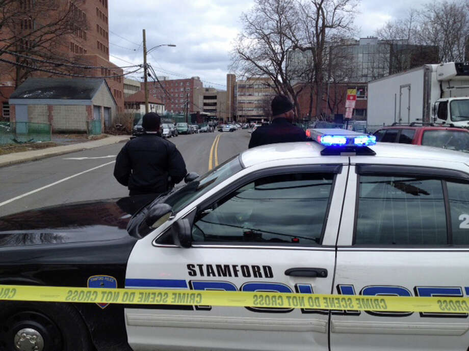 Stamford police responded to a bomb threat Wednesday that evacuated Stamford Academy about 1:30 p.m. Police closed both ends of North Street, where the school is located. The department's tactical unit and bomb squad also responded to the school. Photo: Matthew Brown / Hearst Connecticut Media / Stamford Advocate
