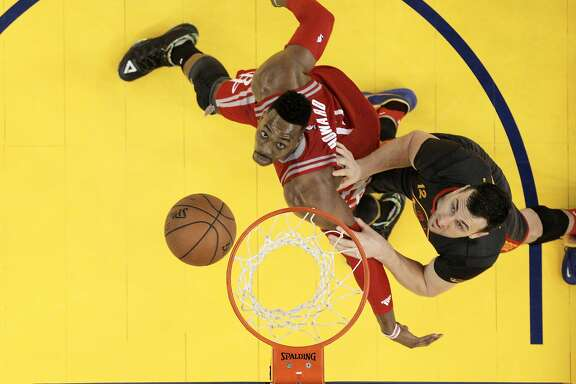 Dwight Howard (12) boxes out Andrew Bogut (12) for a rebound in the first half of the game between the Golden State Warriors and the Houston Rockets at Oracle Arena in Oakland, Calif., on Tuesday, February 9, 2016.  The Warriors won 123-110.