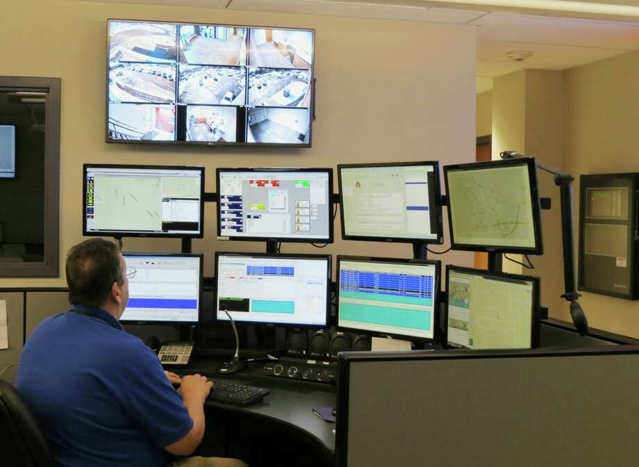Trumbull Police Dispatcher John Butz works at the new Emergency Communications Center console at police headquarters Photo: Trumbull Police Department /contributed Photo
