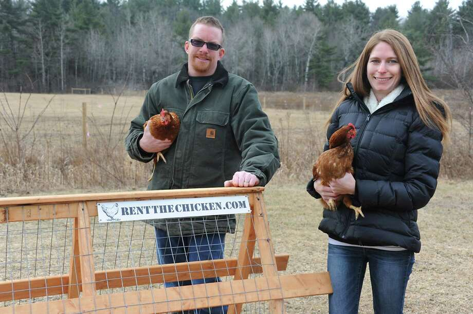 Joshua and Victoria Slingerland hold a couple chickens near a coop on Slingerland Family Farm Monday, Feb. 8, 2016 in Greenville, N.Y. (Lori Van Buren / Times Union) Photo: Lori Van Buren / 10035272A