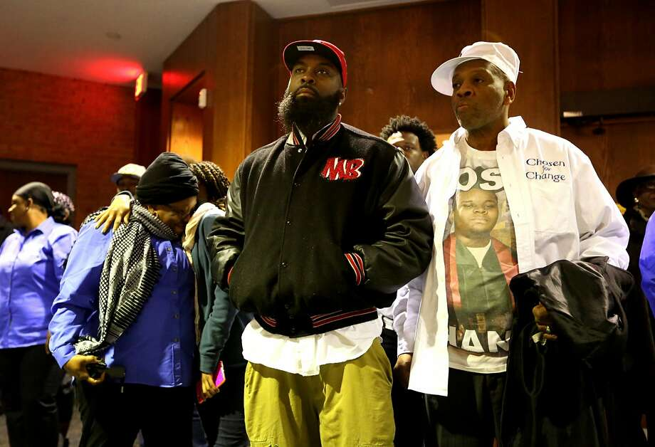 Michael Brown's father, Mike Brown Sr. (enter), listens at a City Council meeting about a deal with the U.S. Justice Department. Photo: David Carson, Associated Press