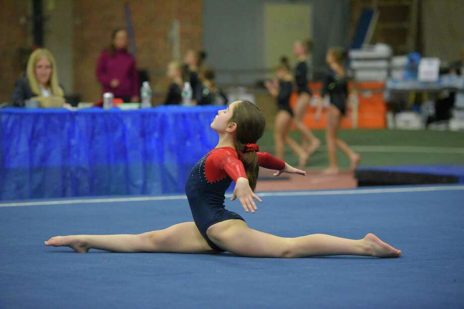Darien Ymca gmnast Anna Altier does a split. Photo: Contributed / Darien News