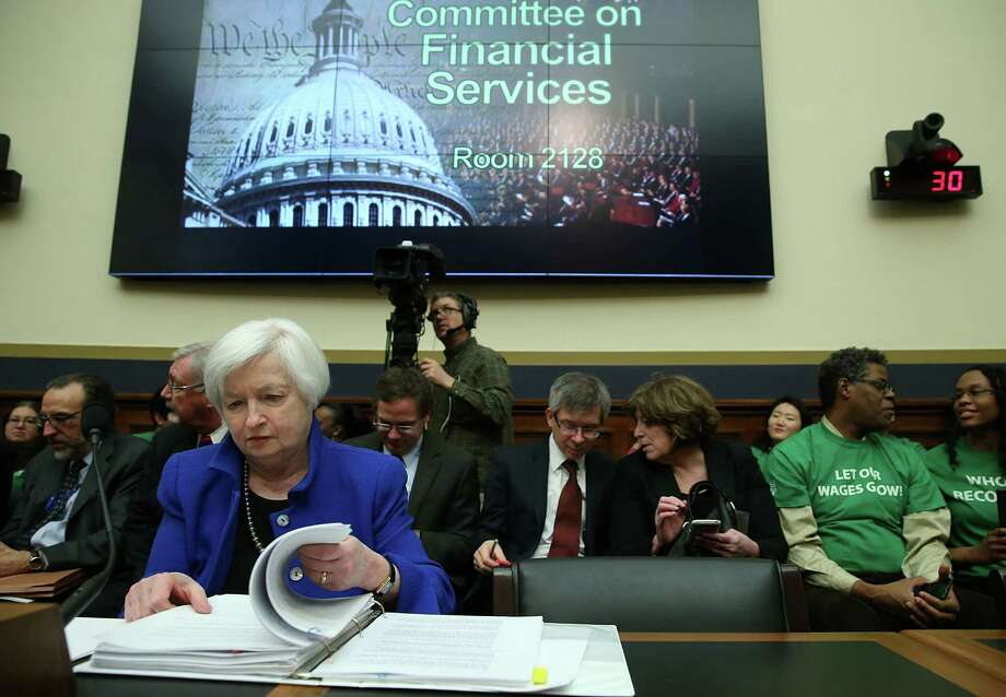 Federal Reserve Chairwoman Janet Yellen looks over her papers during a House Financial Services Committee hearing on Capitol Hill.Sshe sounded more worried than at her last public appearance, but said it was too soon to assess any damage from the financial turmoil. Photo: Mark Wilson /Getty Images / 2016 Getty Images