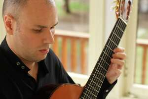 Free guitar recital at library - Photo