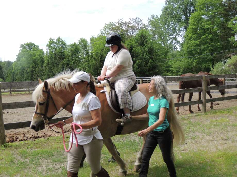 Lisa Griffin of New Canaan learns to ride as part of the STAR, Inc., Lighting the Way program. Photo: Contributed / Contributed Photo / New Canaan News
