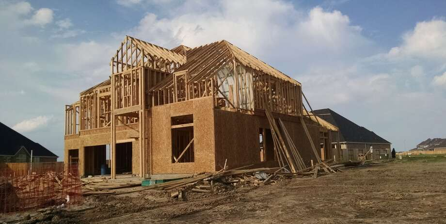 A house goes up in The Reserve at Clear Lake City community in late August 2015. (Bill Montgomery  /  Houston Chronicle photo)