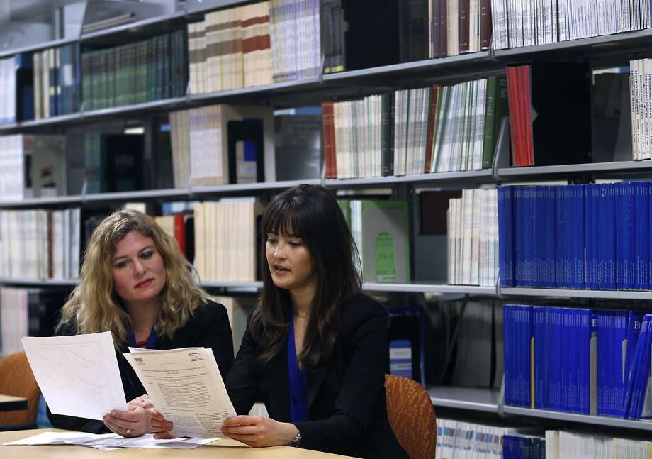 Kaiser Permanente researcher Rachel Whitmer (left) and UCSF post doc Elizabeth Rose Mayeda review data collected from a 14-year study on Alzheimer's and six ethnic and racial groups in Oakland, Calif. on Wednesday, Feb. 10, 2016. Their findings were released in Alzheimer's and Dementia, the journal of the Alzheimer's Association. Photo: Paul Chinn, The Chronicle
