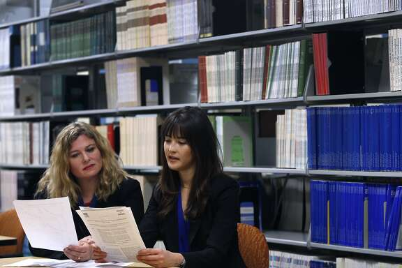 Kaiser Permanente researcher Rachel Whitmer (left) and UCSF post doc Elizabeth Rose Mayeda review data collected from a 14-year study on Alzheimer's and six ethnic and racial groups in Oakland, Calif. on Wednesday, Feb. 10, 2016. Their findings were released in Alzheimer's and Dementia, the journal of the Alzheimer's Association.