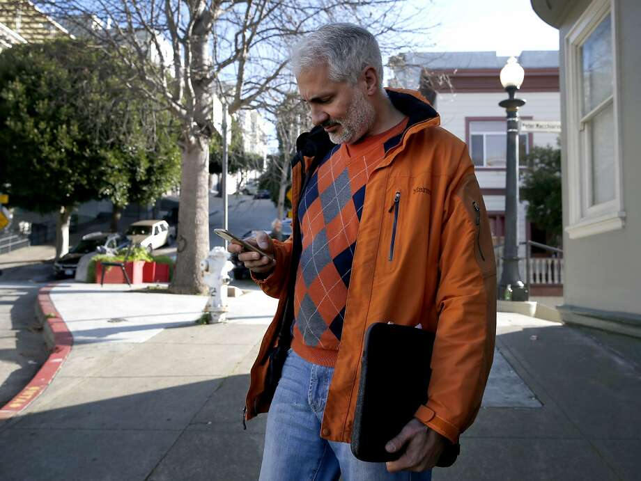 Sandeep Hingorani is seen a block away from the building on Vallejo Street where he owns a TIC unit in San Francisco, Calif. on Thursday, Feb. 4, 2016. Tom Payne and Michelle Huang, who own three units in the same building, say Hingorani rented one of theirs through Airbnb using an alias and is now claiming residency asserting tenants rights. Photo: Paul Chinn, The Chronicle