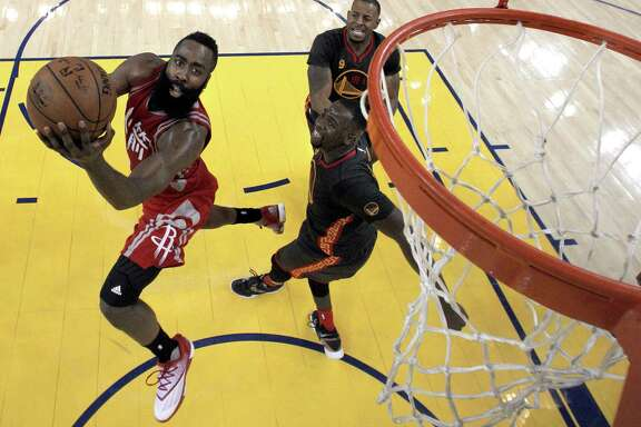 After a scoreless first quarter, Rockets guard James Harden, left, torched the Warriors for 37 points Tuesday night.