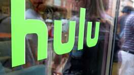The Wall Street Journal reports that Time Warner is in talks to invest in Hulu and has told Hulu's owners it wants to curtail current-season TV episodes.